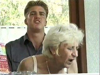 Ficky Martin fucks a blonde hairy granny very hard on the hotel desk