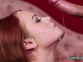 Flirty stunner gets jizz shot on her face eating all the cum